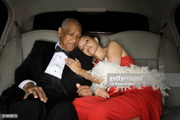Senior African couple hugging in limousine