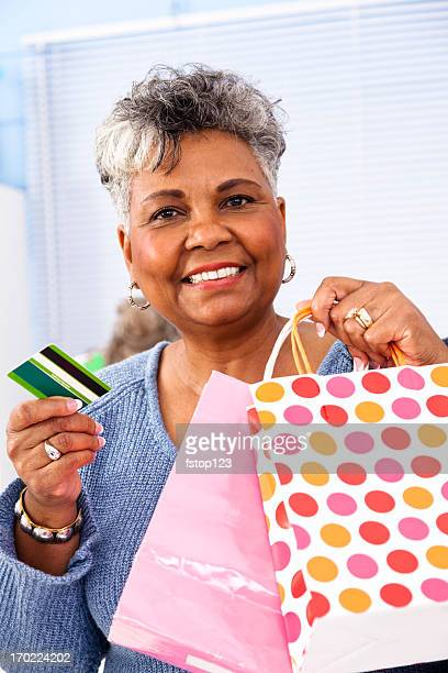Senior African Descent Woman making a purchase at boutique store