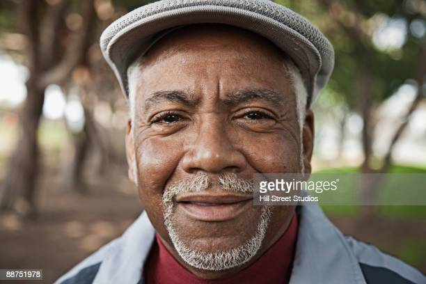 Senior African man in park