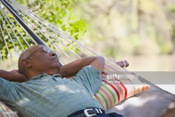 Senior African man laying in hammock