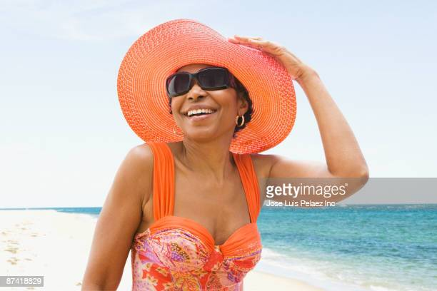 Senior African woman in bathing suit on beach