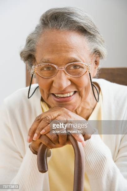 senior african woman leaning on cane - leaning disability stock pictures, royalty-free photos & images