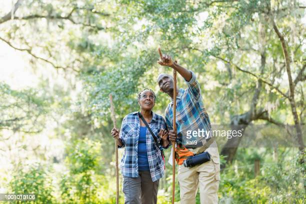 Senior African-American couple hiking, exploring