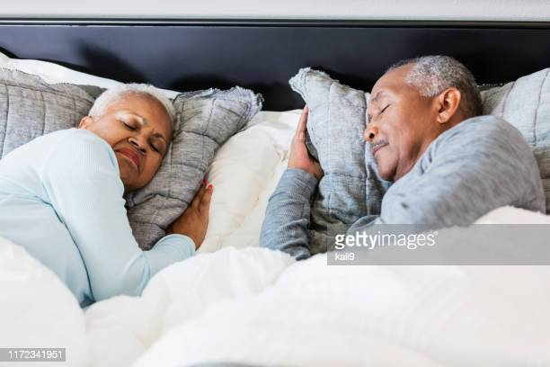 senior african-american couple sleeping - lying on side stock pictures, royalty-free photos & images