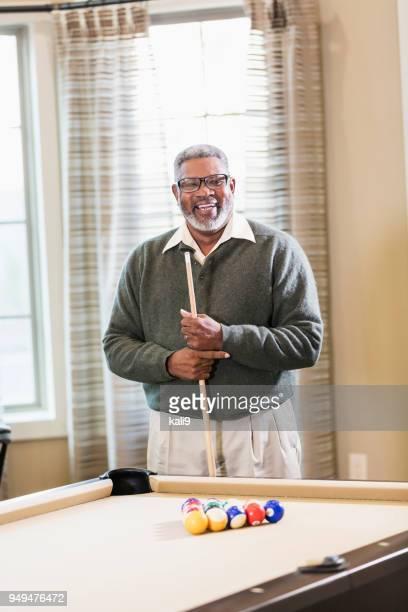 senior african-american man shooting pool - old men playing pool stock pictures, royalty-free photos & images