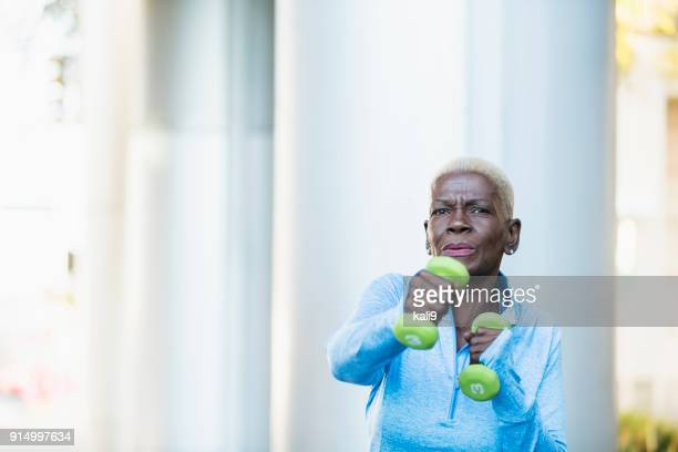 senior african-american woman exercising, hand weights - hand weight stock pictures, royalty-free photos & images