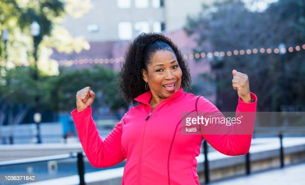 senior african-american woman exercising in city - fat old women stock pictures, royalty-free photos & images