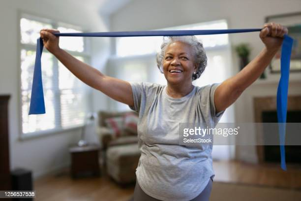 senior african-american woman exercising inside the house - aerobics stock pictures, royalty-free photos & images