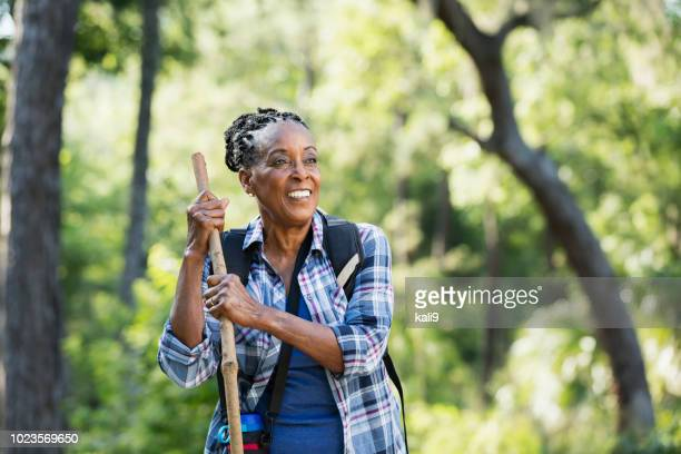 senior african-american woman hiking - hiking pole stock pictures, royalty-free photos & images