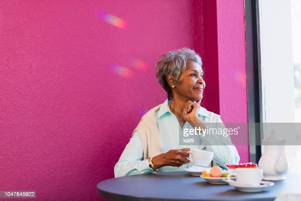 Senior African-American woman in coffee shop