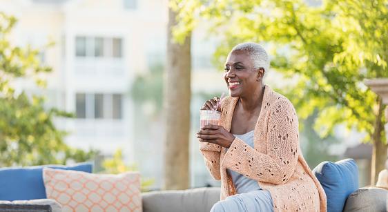 Senior African-American woman relaxing on patio - gettyimageskorea