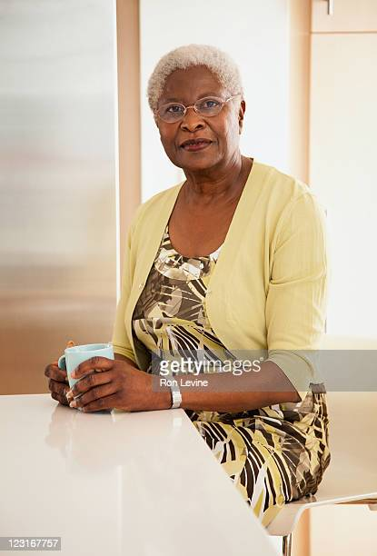 Senior african-american woman sitting  in kitchen