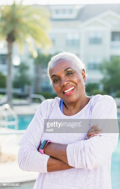 Senior African-American woman standing on pool deck
