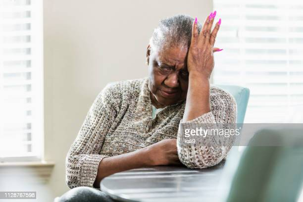 senior african-american woman with headache, upset - fat old women stock pictures, royalty-free photos & images