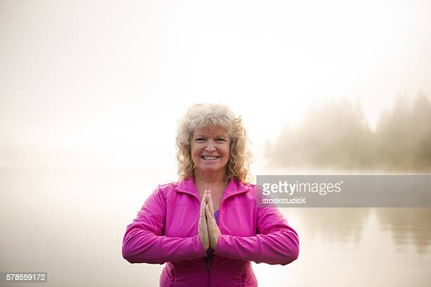 Senior aged woman practicing yoga