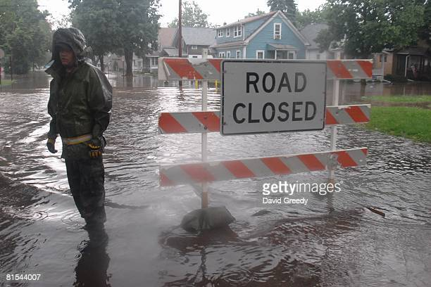 Senior Airman Chris Divis of the 185th Air National Guard of Sioux City, Iowa mans the perimeter of the evacuation zone on June 12, 2008 in Cedar...