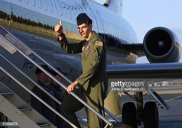 Senior Airman Curt Towne gives a thumbsup 14 April 2001 before boarding a C9 Skytrain at Hickam Air Force Base bound for a homecoming at Whidbey...