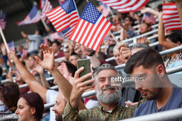 senior american fan taking a selfie at stadium - old american football stock photos and pictures