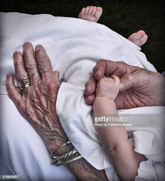 Senior and baby's hands and feet