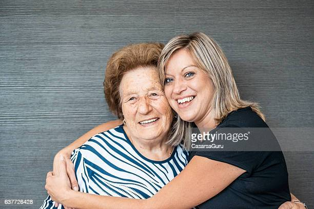 Senior and Caregiver Portrait in an Elderly Daycare Cente