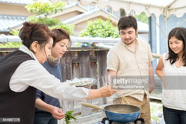 Senior and Mature Japanese Women Teaching Cooking to Young People