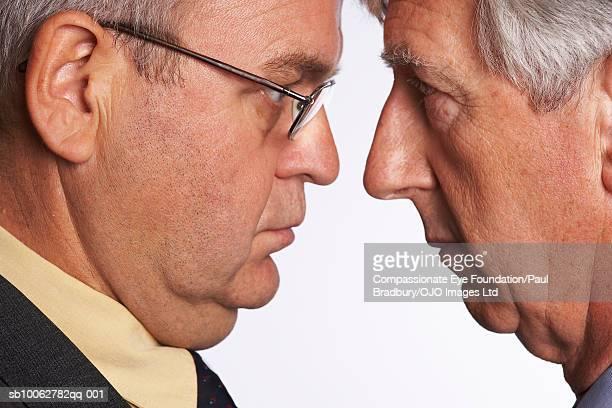 Senior and mature man face to face, close-up, profile