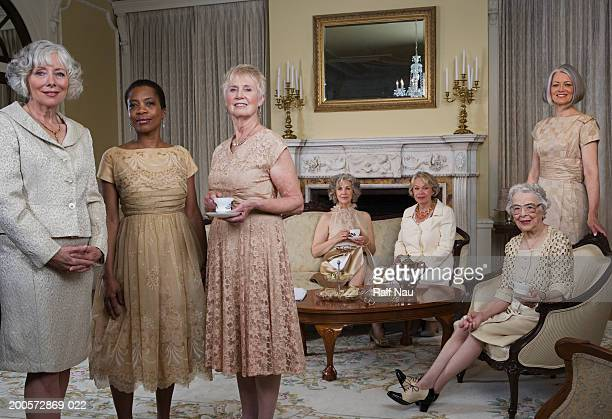 Senior and mature women at tea party, portrait