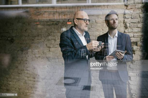 senior and mid-adult businessman having a meeting - successor stock pictures, royalty-free photos & images