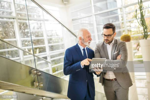 senior and young management - free business coaching stock pictures, royalty-free photos & images
