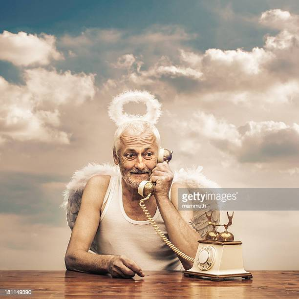 senior angel holding telephone receiver