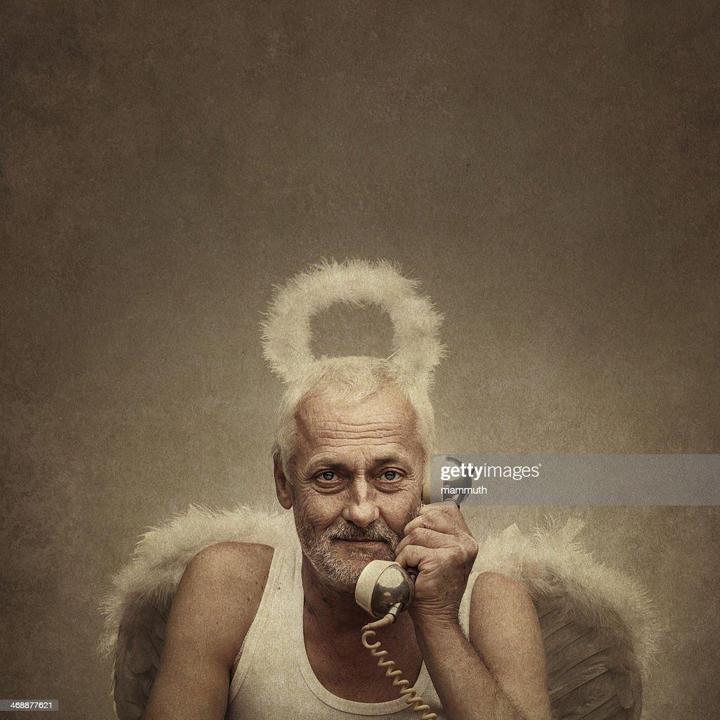 senior angel holding telephone receiver : Stock Photo