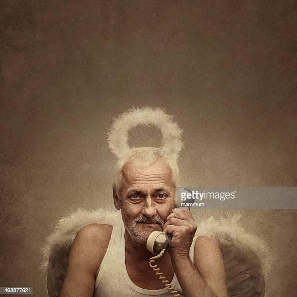 senior angel holding telephone receiver
