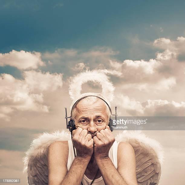 senior angel with receiver-headphones