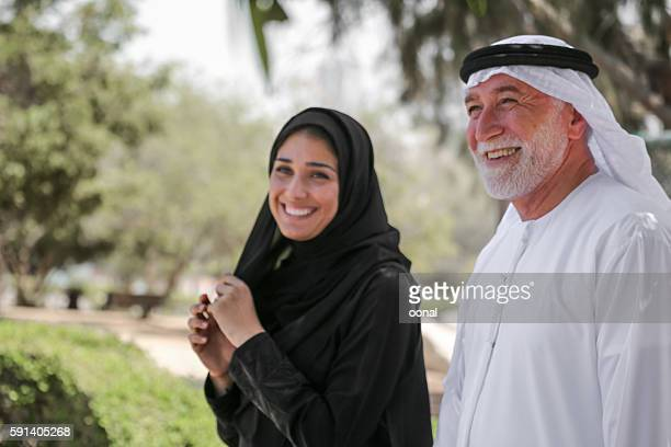 Senior arab man and young woman