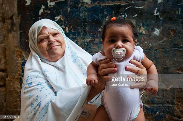 arab baby and grandmother in sidon lebanon - lebanese ethnicity stock photos and pictures