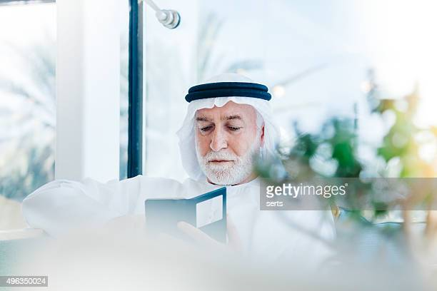 Senior Arabian Man with cellphone