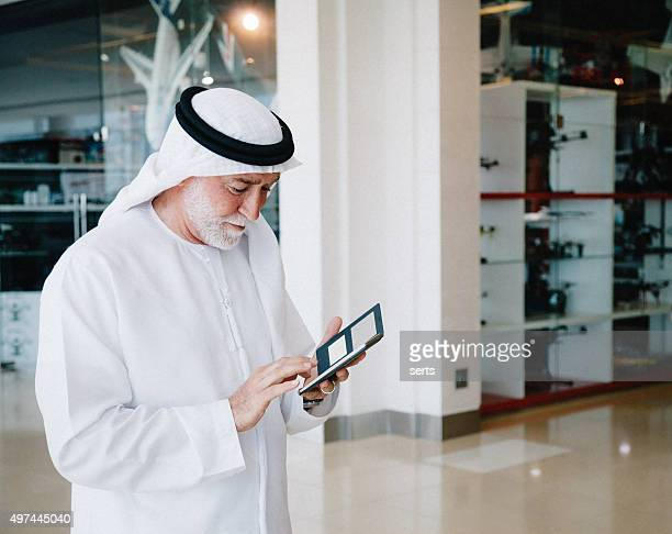 senior arabian man with cellphone - arab old man stock pictures, royalty-free photos & images