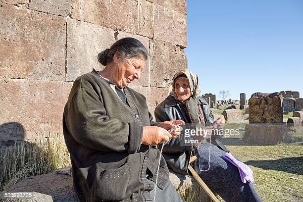 senior armenian women knitting and talking - armenia stock pictures, royalty-free photos & images