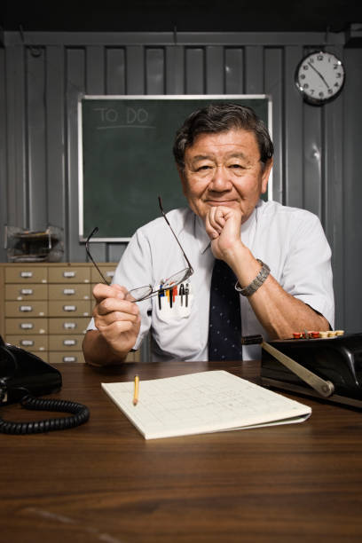 Senior Asian businessman at desk
