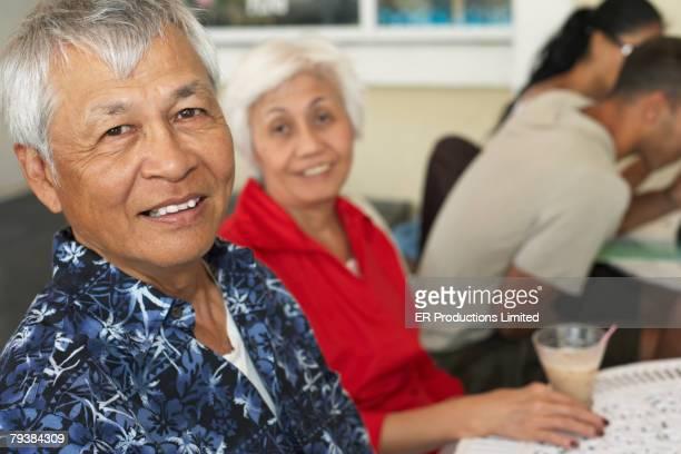 Senior Asian couple at cafe