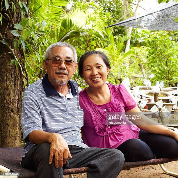 Senior Asian couple smiling together