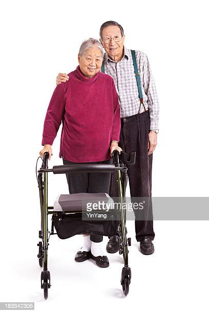 Senior Asian Couple Using Orthopedic Walker for Physical Therapy Exercise