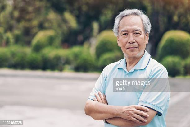 senior asian ethnicity man - east asian culture stock pictures, royalty-free photos & images
