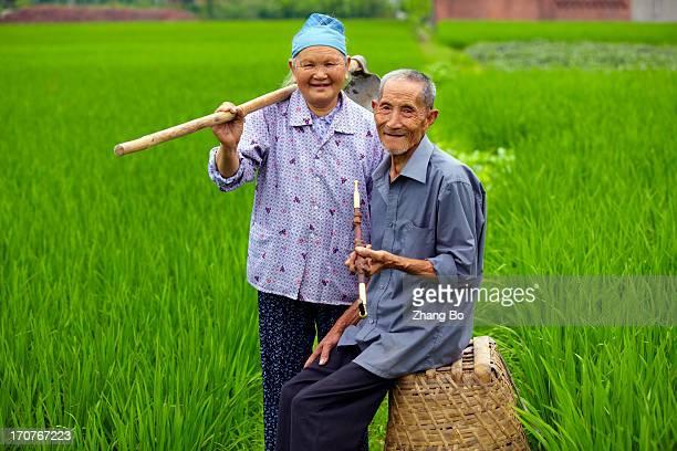 senior Asian farmer in countryside