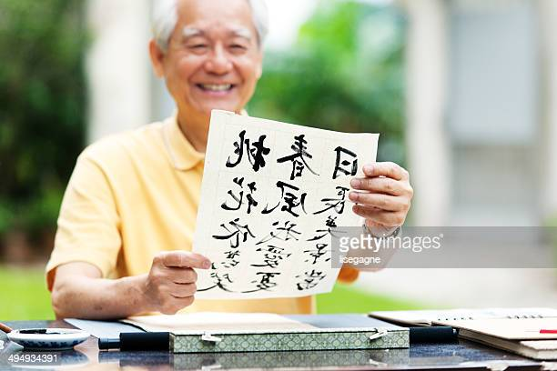 Senior asian man doing calligraphy