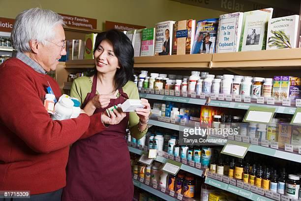 Senior Asian man shopping for natural medicine