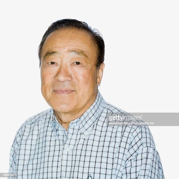 senior asian man wearing button down shirt - 60 69 years stock pictures, royalty-free photos & images