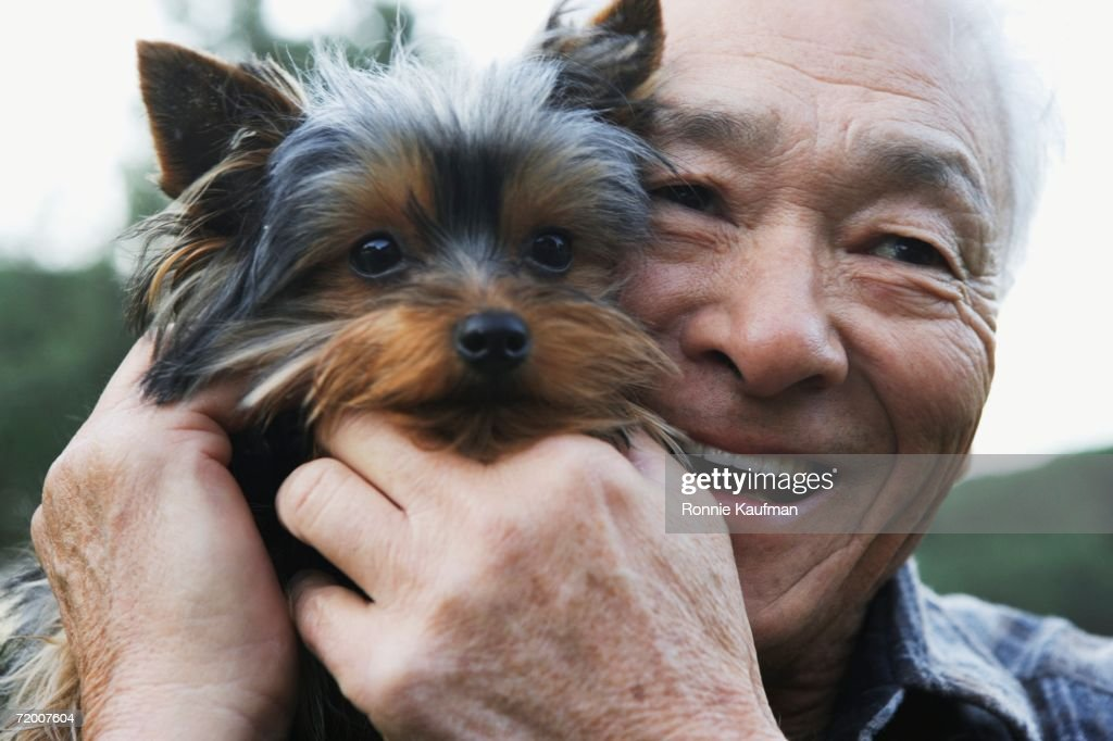 Senior Asian man with small dog : Stock Photo