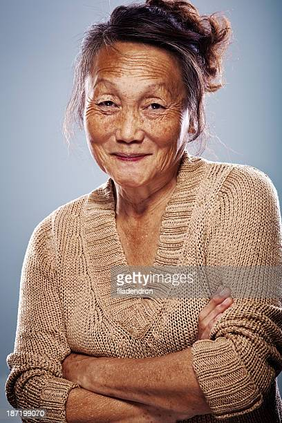 senior asian woman - inuit stock pictures, royalty-free photos & images