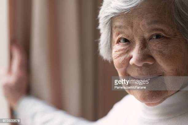 senior asian woman portrait, smiling - independence stock pictures, royalty-free photos & images